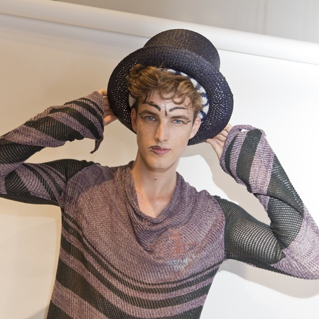 British model James Smith poses backstage at Vivienne Westwood's show.