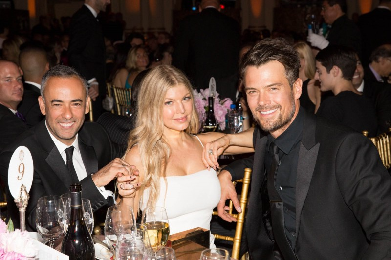 Calvin Klein Collection women's creative director Francisco Costa, singer Fergie and her husband, actor Josh Duhamel