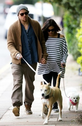 Channing Tatum and then pregnant wife Jenna Dewan-Tatum take their dogs for a walk in May 2013.