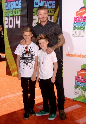 David Beckham poses for a photo with his sons Romeo and Cruz.