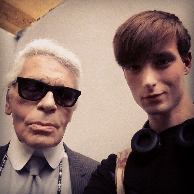 Laurie Harding poses for a photo with Karl Lagerfeld.