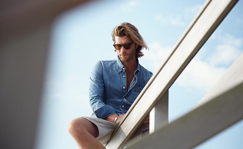 Pilcher wears sunglasses Garrett Leight California Optical, shirt Acne Studios and shorts NN.07.