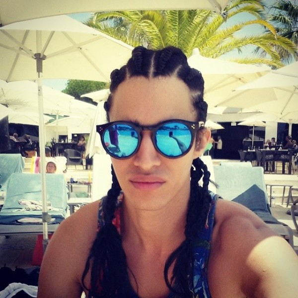Luis Borges relaxes poolside with his fresh new braids