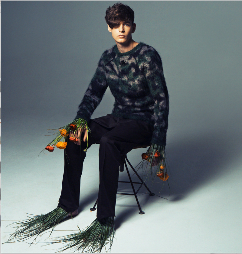 Mihail wears sweater Philipp Plein and trousers UNIQLO.