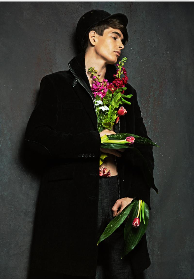 Mihail wears coat Philipp Plein, trousers Zara and cap Wood Wood.