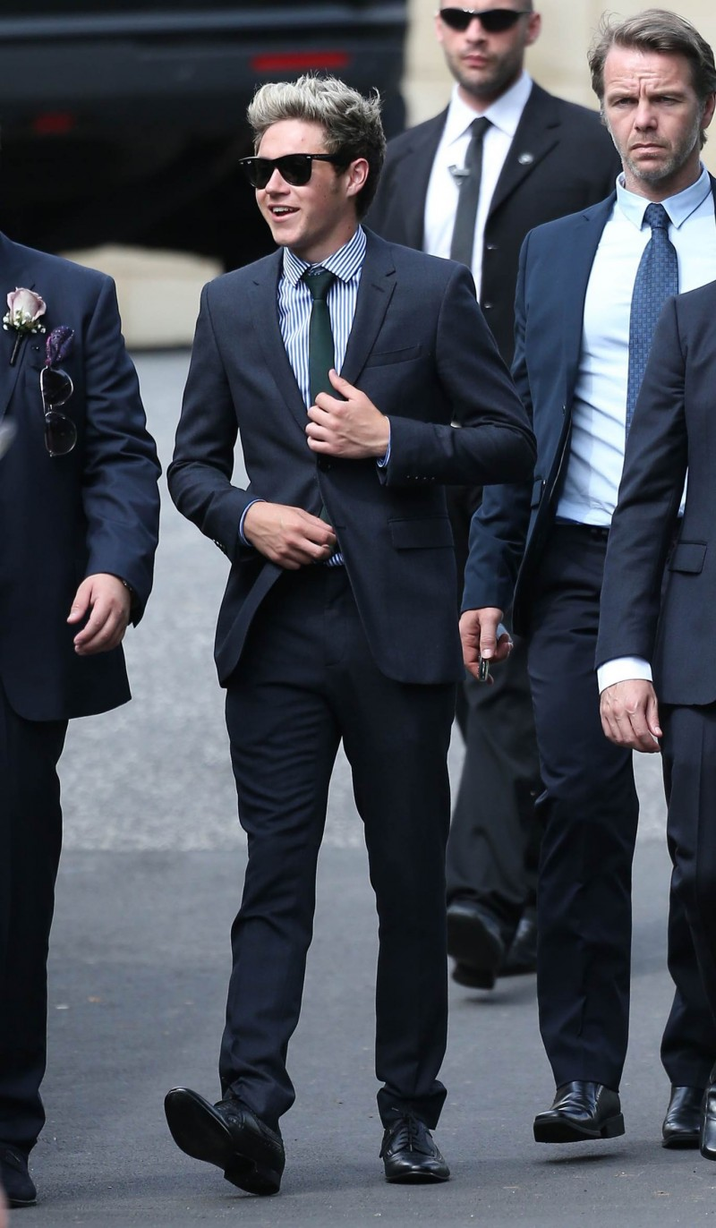 Niall Horan wearing Burberry tailoring to a wedding over the weekend