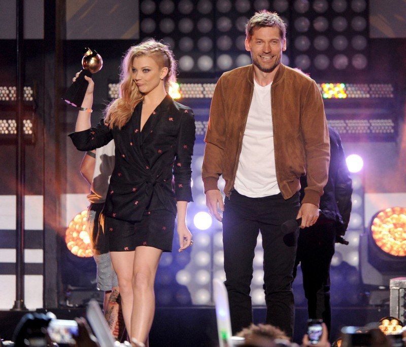 Nikolaj Coster-Waldau and 'Game of Thrones' co-star Natalie Dormer accept an award at MTVu Fandom Awards at Comic-Con. Coster-Waldau wears a suede varsity jacket from Todd Snyder.
