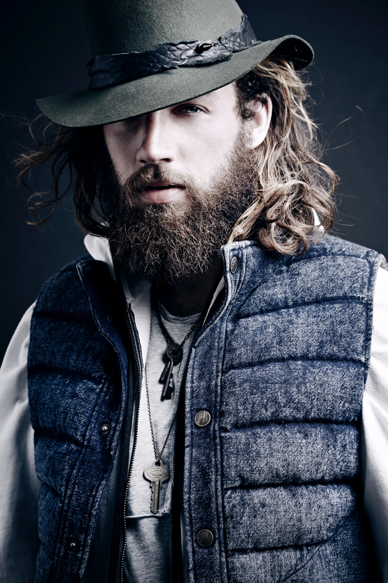 Phil wears t-shirt and hooded sweater Daniel Patrick, denim down vest Matiere and hat Lor-e Philips.