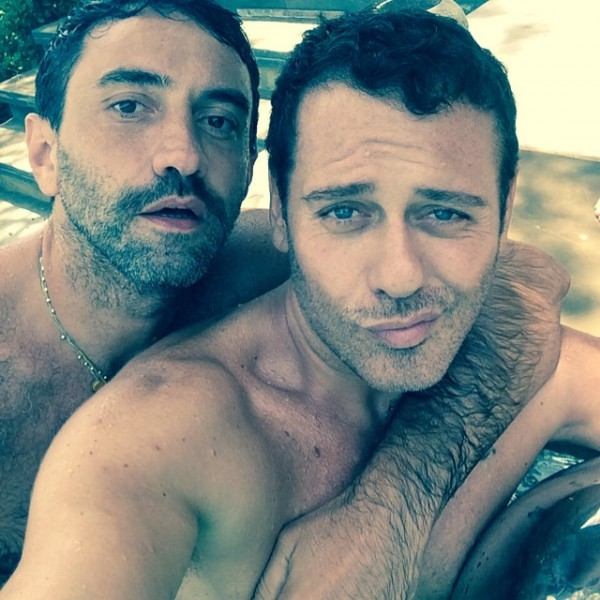 Riccardo Tisci and Mert Alas pose for a pool image.
