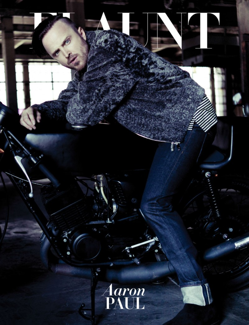 Aaron Paul wears shearling bomber Ermenegildo Zegna Couture, striped long sleeve cotton s-shirt Lanvin, rebel straight denim jeans Cult of Individuality, leather boots Roberto Cavalli and leather belt Emporio Armani.