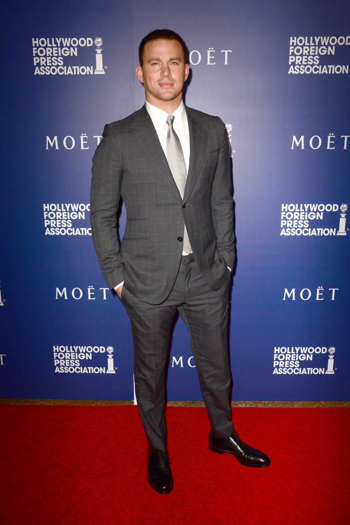 Channing Tatum cleans up in a gray windowpane suit from Italian fashion house Gucci.