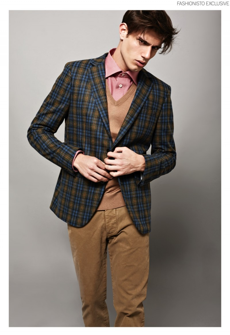 Marco wears jacket and trousers Massimo Rebecchi, v-neck sweater Caruso and shirt Eton.