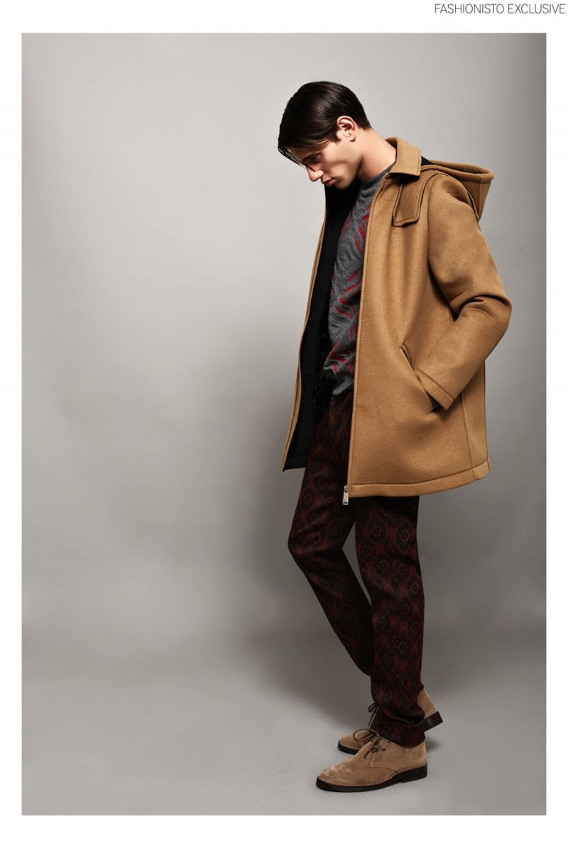 Marco wears coat Frankie Morello, knit sweater Roberto Cavalli, trousers Cavalli Class and shoes Lumberjack.