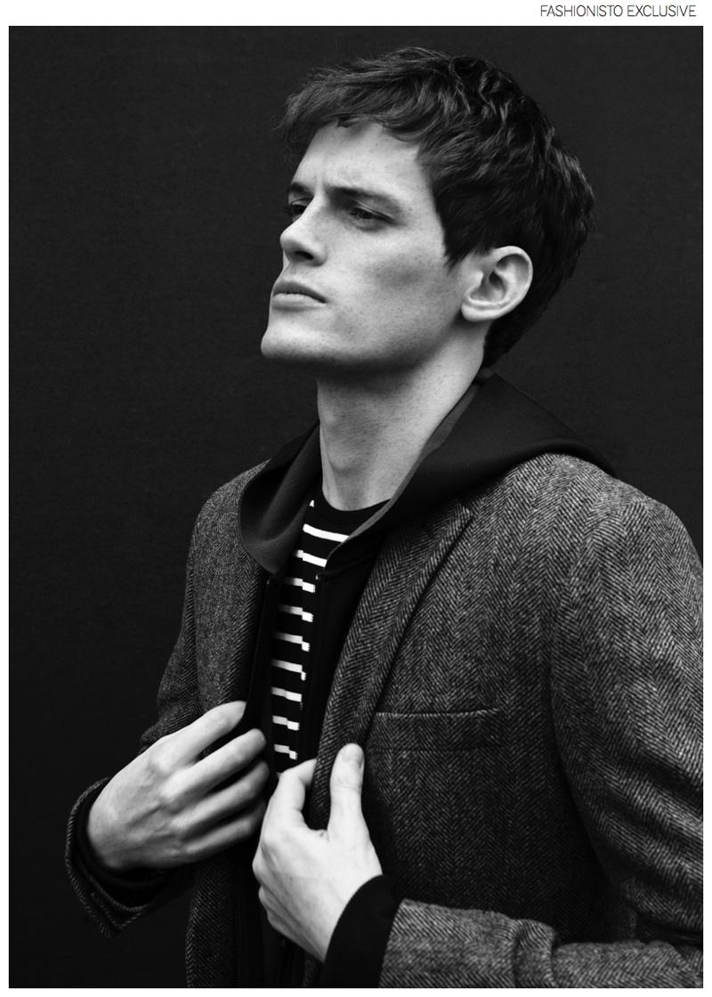 Marcus wears blazer Morris, hoodie and sweater Filippa K.
