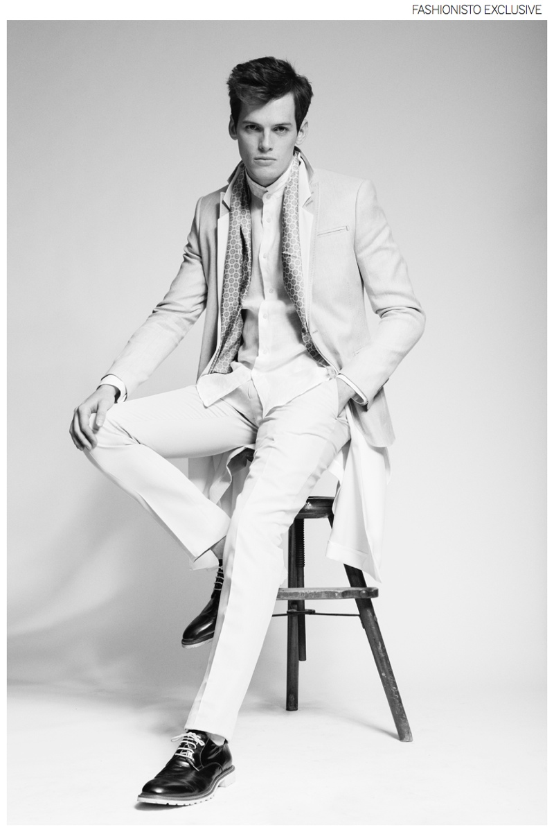 Marcus wears shirt 7 For All Mankind, cape stylist's own, scarf Edsor, shoes J.Lindeberg, blazer and trousers Hugo Boss.