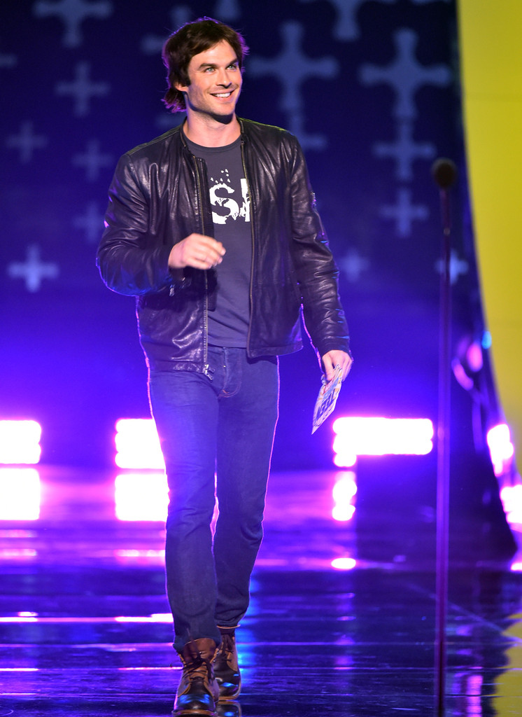 Ian Somerhalder pairs a simple graphic t-shirt with a leather jacket and jeans