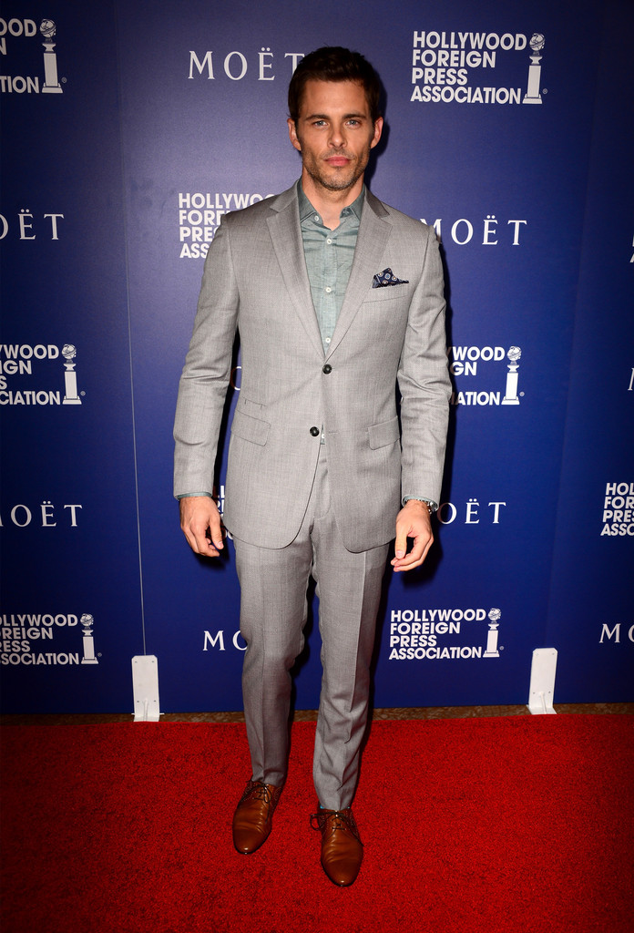James Marsden charms in a gray two-button notch lapel suit from Italian label Z Zegna.