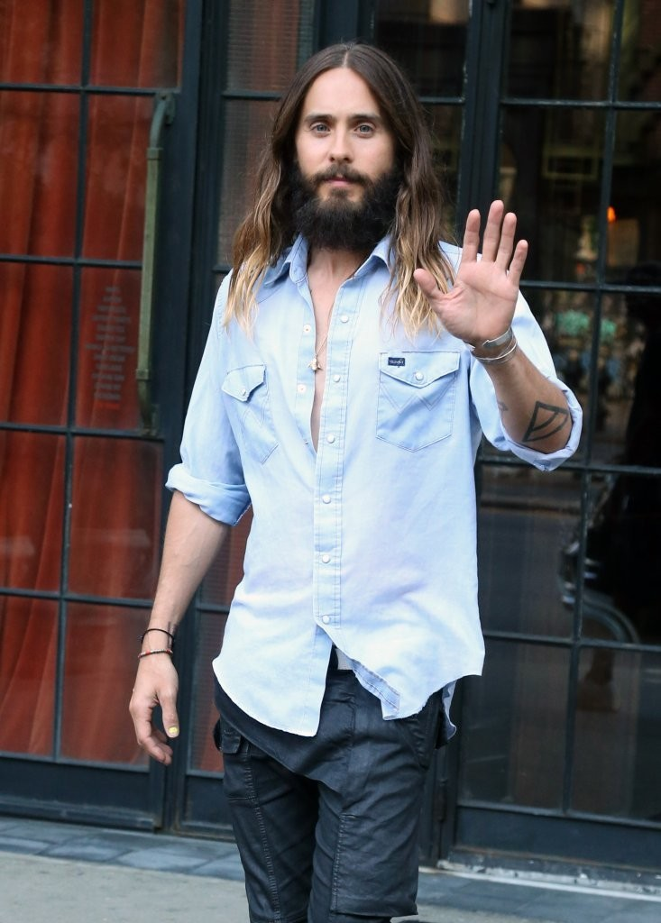 Jared Leto wears a light washed denim shirt as he heads out to run errands in New York City on August 14th.
