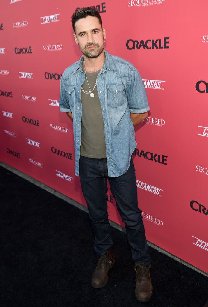 Actor Jesse Bradford wears a short-sleeve denim shirt to Crackle Presents: Summer Premieres Event on August 14th.