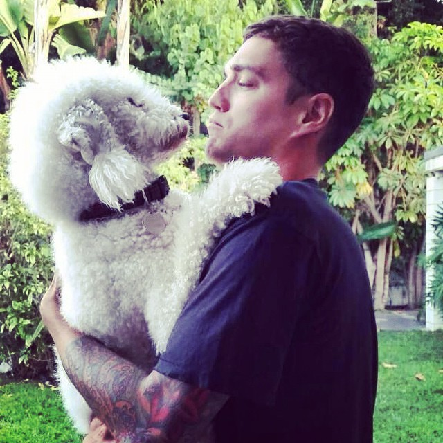 Josh Beech cozies up to man's best friend.
