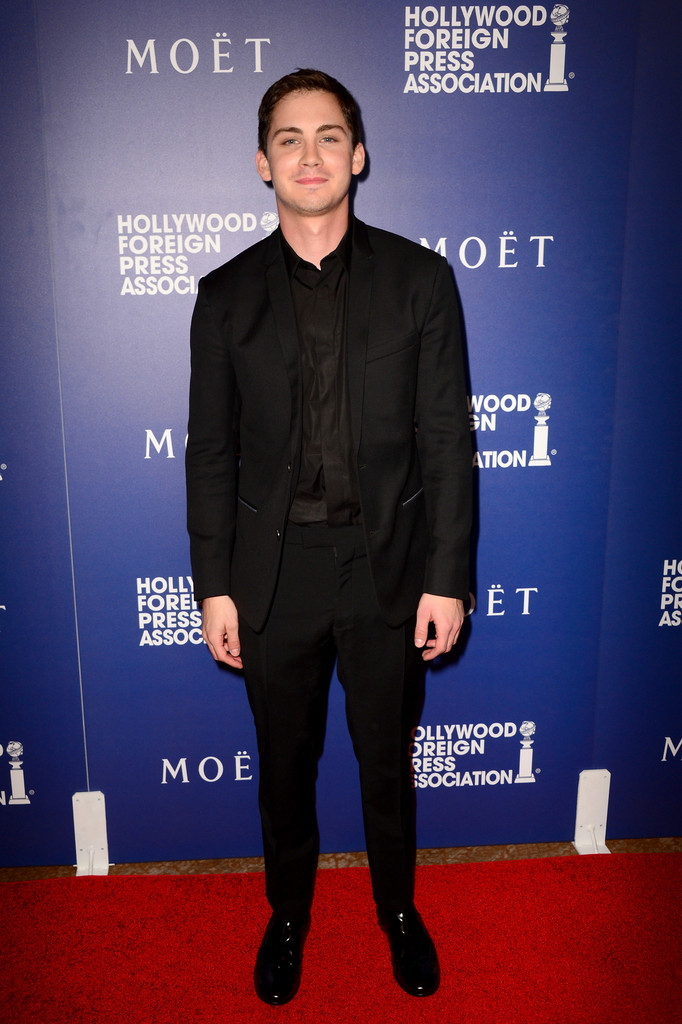 A vision in black with hair to match, actor Logan Lerman wears a Dior Homme wool two-button small lapel suit with denim lining, a black cotton shirt and black leather derbies.