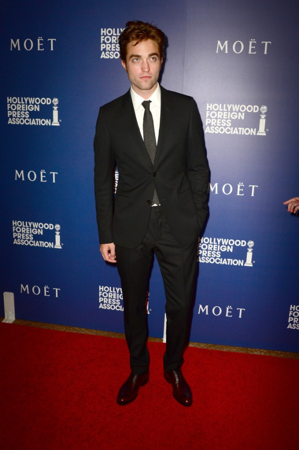 British actor Robert Pattinson keeps things simple in a black Gucci suit.