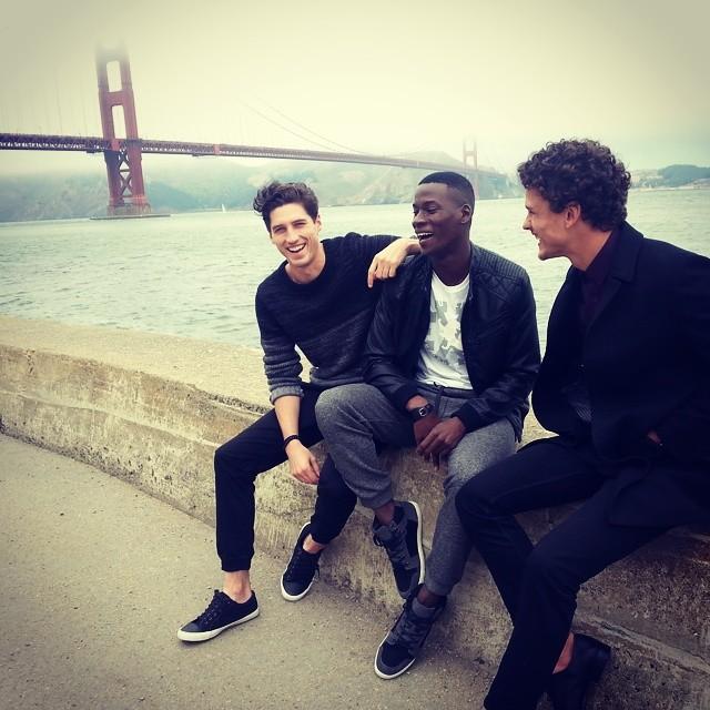 Ryan Kennedy, David Agbodji and Simon Nessman pose by the Golden Gate Bridge.