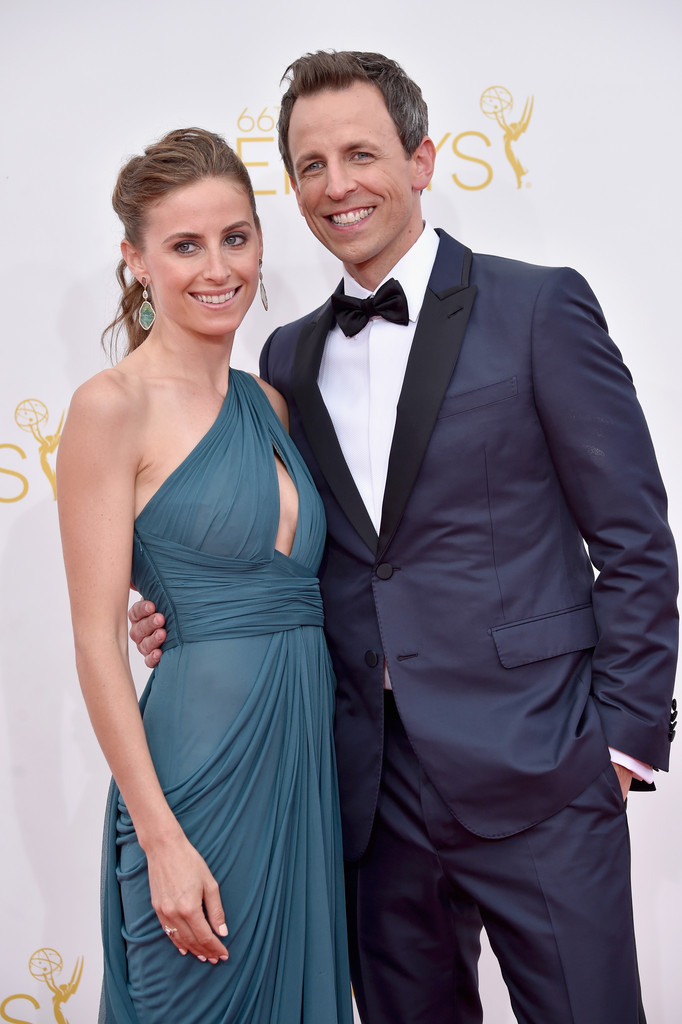 Host of this year Emmys, Seth Meyers and his wife Alexi Ashe. The late-night host went for a dapper tuxe in midnight blue.