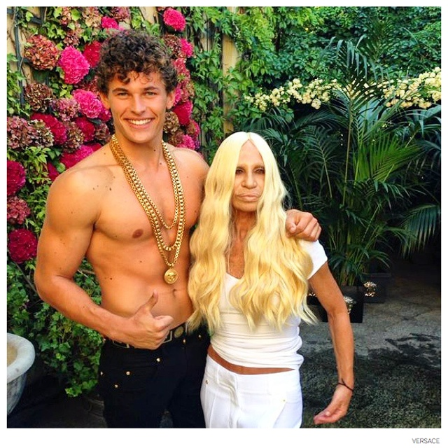 Donatella Versace poses with model Maximilian Wefers.
