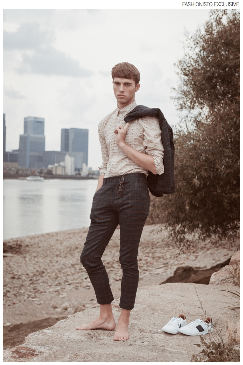 Yarik wears suit ASOS, shirt Gabicci, sunglasses stylist's own and shoes Fred Perry.