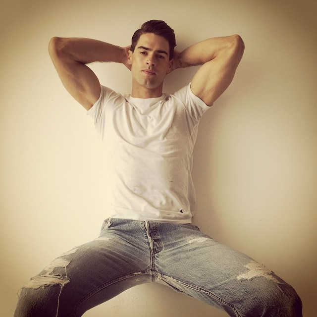 Chad White poses in a simple tee and pair of jeans.