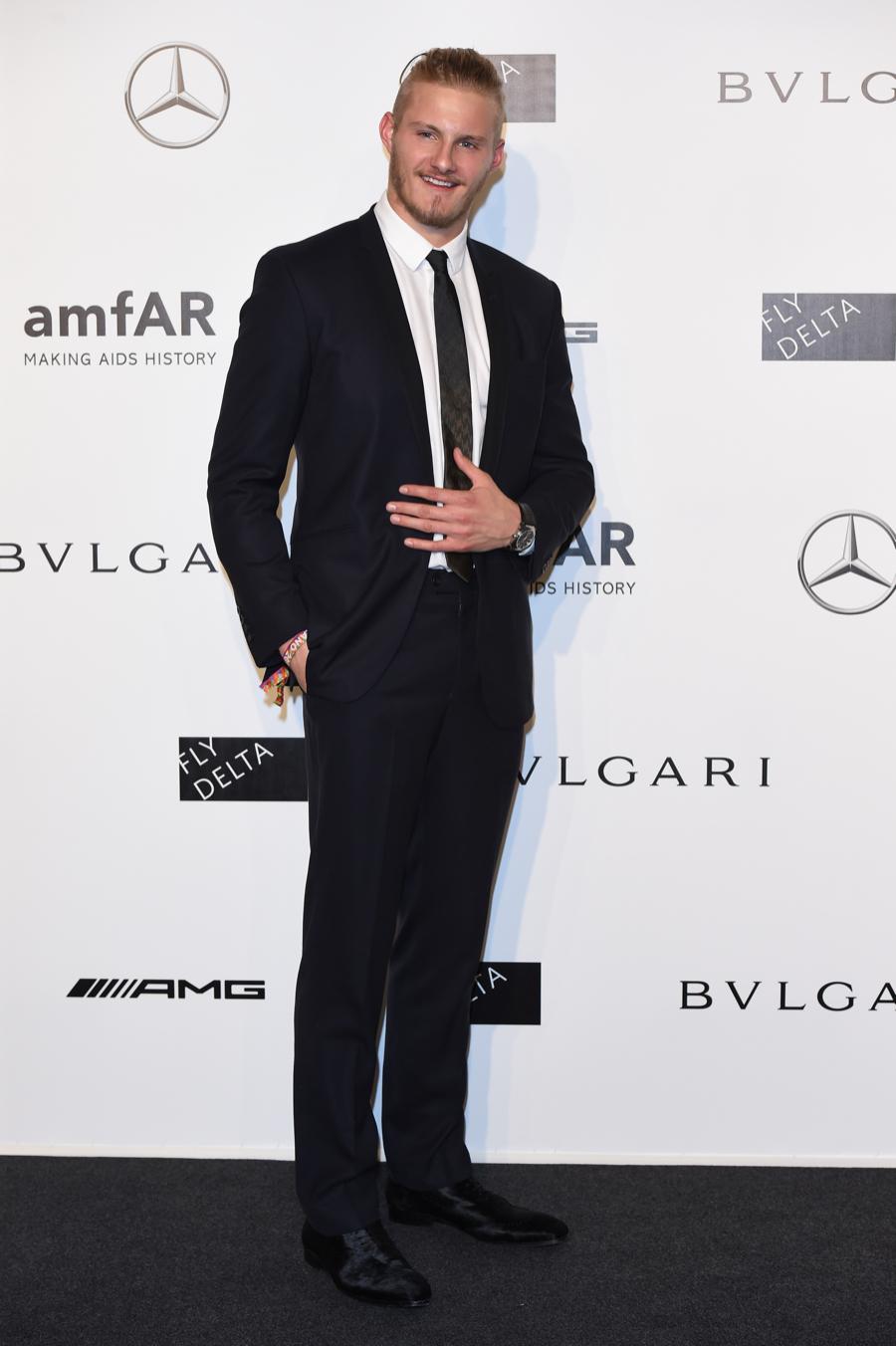 Alexander Ludwig Wears Bulgari to amfAR Milano Gala