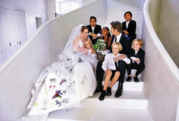 Newlyweds Brad Pitt and Angelina Jolie pose for a family photo with their children. Photo Credit: People Magazine