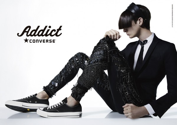 MMO model Corentin Renault delivers an intriguing edge for Converse Addict's fall/winter 2014 campaign. The model is featured with a long set of bangs, a tailored suit jacket, skinny tie and bejeweled pants, completed with a pair of Converse.