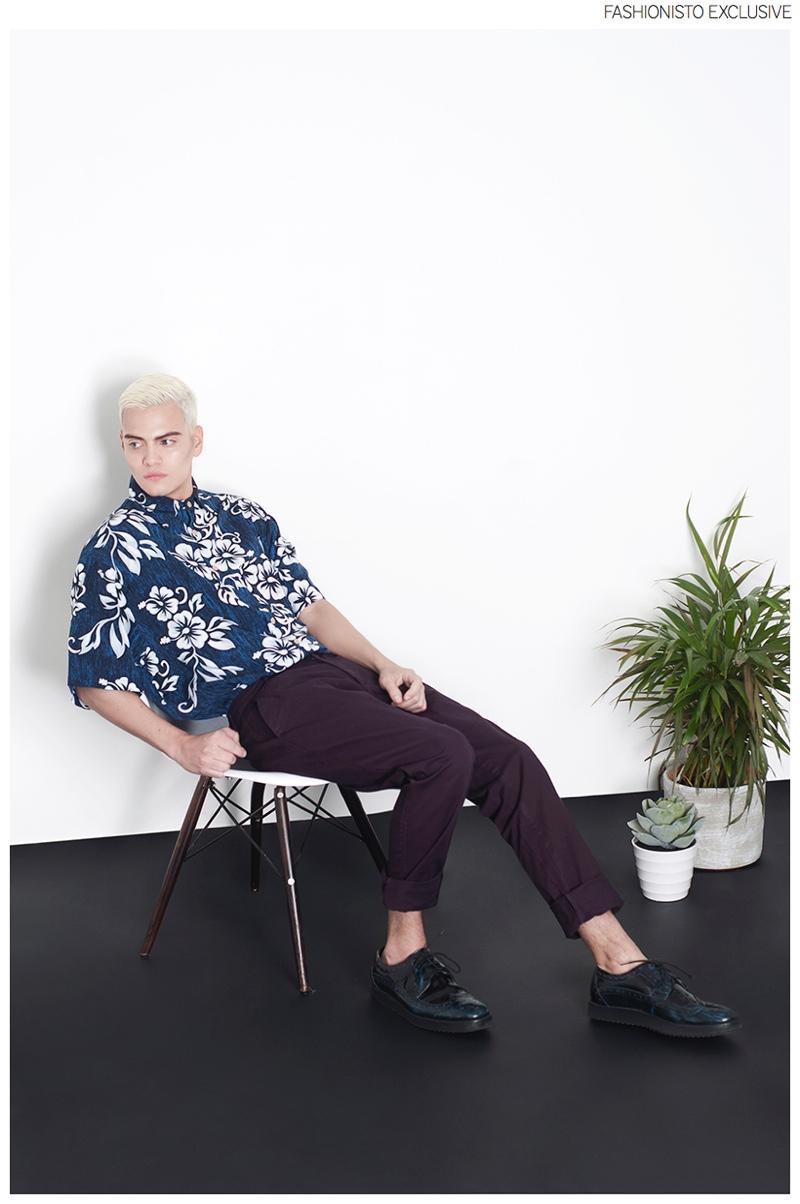 Juan wears vintage shirt stylist's own, trousers Zara and shoes Juan.