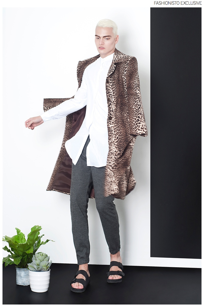 Juan wears coat Eriko from The Backroom, shirt ASOS, trousers River Island and sandals Birkenstock.