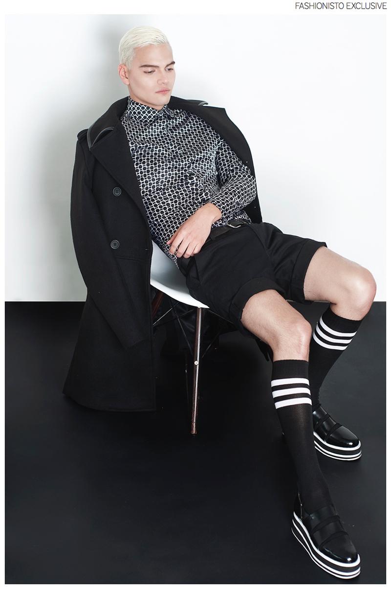 Juan wears coat Juan, shirt The Backfroom, shorts 3.1 Phillip Lim, socks and shoes stylist's own.
