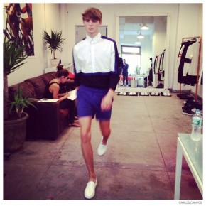 Guerrino Santulliana wears a spring/summer 2015 look during the fitting.