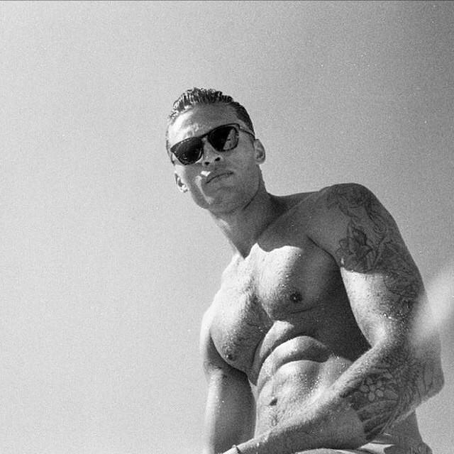 Harvey Haydon shows off a beach ready look - no shirt!