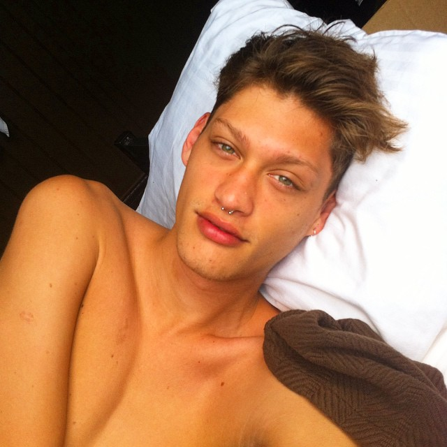 Iago Santibanez takes a selfie from bed.