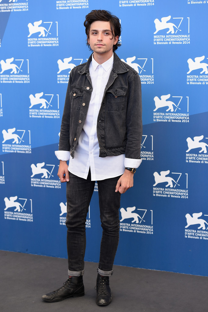 Proportion Play: Actor Jacob Loeb extends his trendy proportions to longer lengths and takes the denim jacket to the Venice Film Festival.