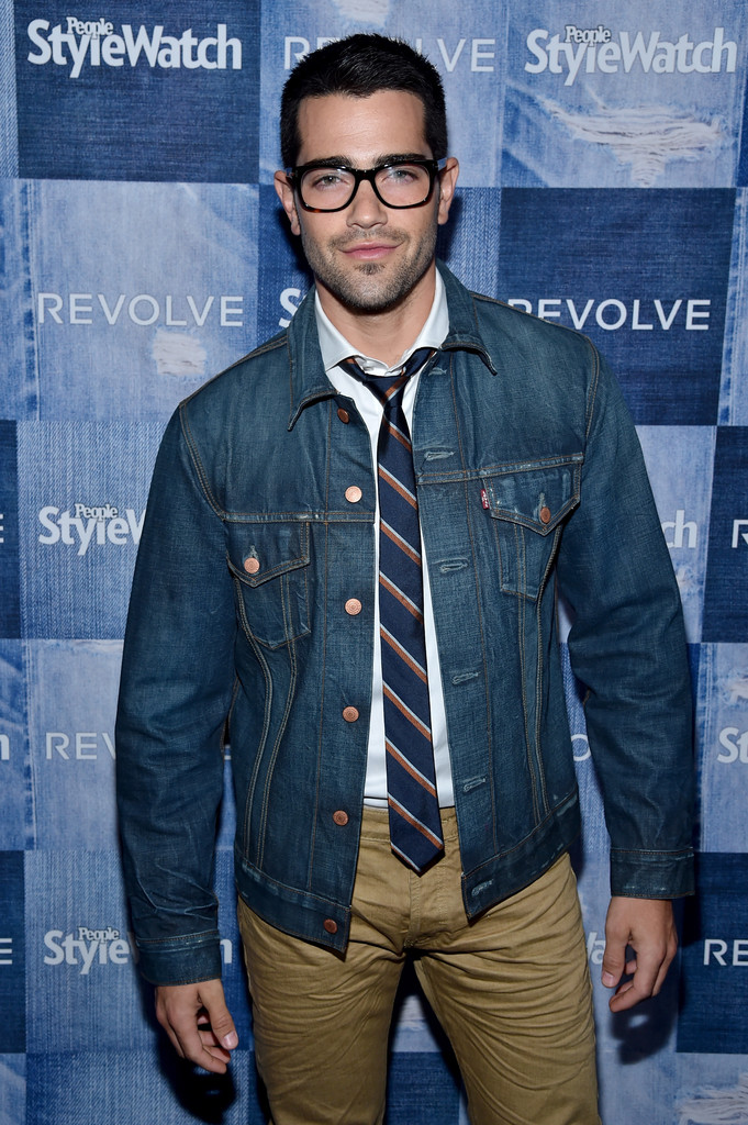 On September 18, 2014, 'Dallas' actor Jesse Metcalfe attended the People StyleWatch Denim Event at The Line in Los Angeles, California. For the event, Metcalfe paired a smart pair of khaki pants with a dress shirt and collegiate tie. Metcalfe finished the looks with a great pair of glasses and an essential Levi's denim jacket.