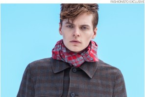 John wears plaid trench coat Robert Geller and scarf Jacqueline Rousseau.