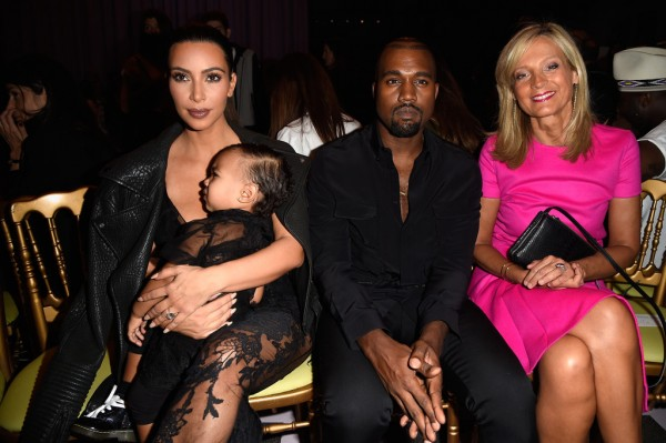 Attending the spring 2015 womenswear show of Givenchy, Kanye West sat front row with his wife Kim Kardashian and daughter North. For the occasion, West wore a black look from Givenchy's menswear collection.
