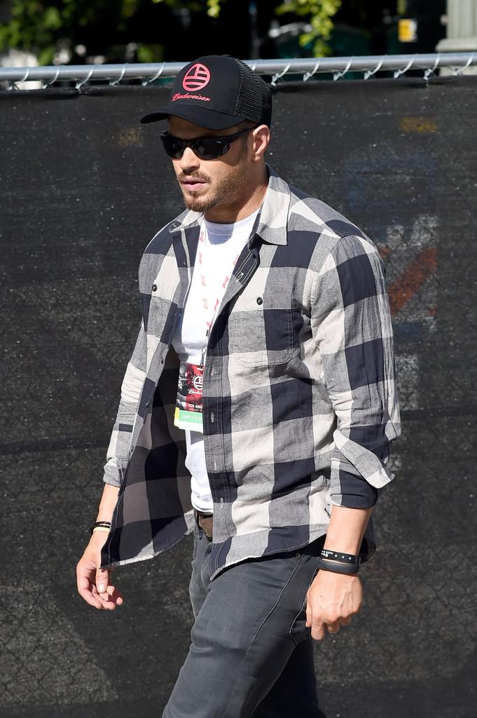 Kellan Lutz Attends Budweiser Made in America Music Festival in Black & White Buffalo Check Shirt