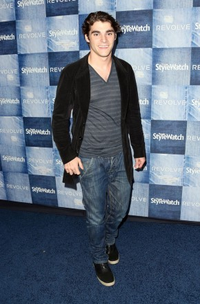 Attending the People StyleWatch Denim event at the Line on September 18, 2014 in Los Angeles, actor RJ Mitte kept his style casual, pairing a relaxed jacket with semi-baggy distressed denim jeans and a striped v-neck shirt.