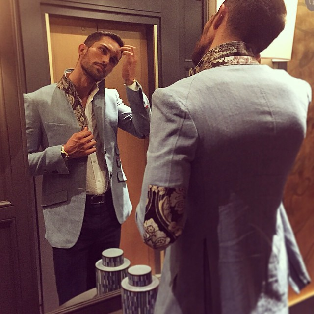 c59ed8a247 Tobias Sorensen primps in front of the mirror.
