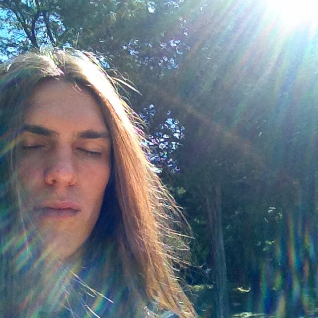 Travis Smith combats a cold with good ol' sunshine.