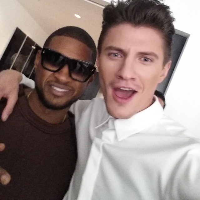 Eli Hall poses for a fashion week photo with the one and only Usher.