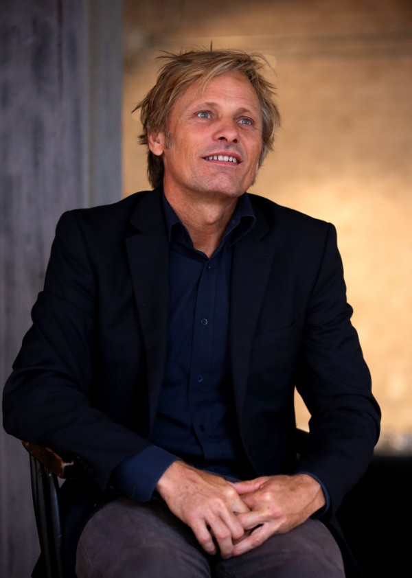 Taking part in the Toronto International Film Festival festivities, actor Viggo Mortensen was in town to promote 'Jauja'. Holding a press conference on September 11th, a newly blond Mortensen wore a navy dress shirt, black sports jacket and gray chinos, opting for a casual but sophisticated ensemble.